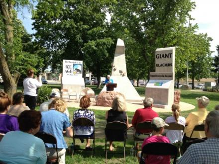 On the SW corner of our round square, Professor George Callison addresses the crowd at the dedication of the Ice Age Monument